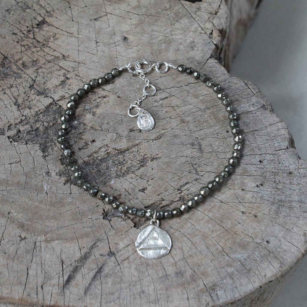 silver 'explore' glyph bracelet with genuine hematite stones