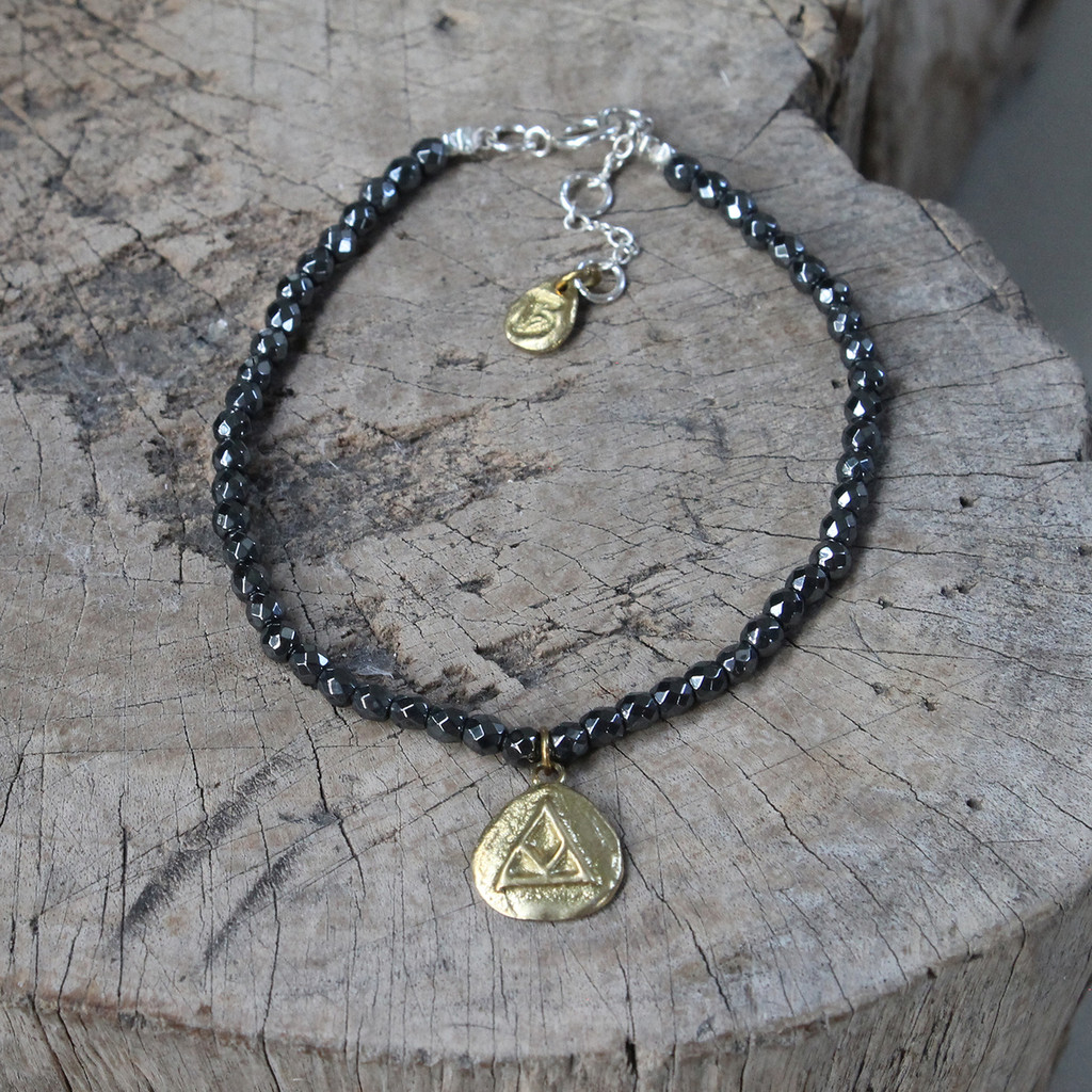 brass 'transition' glyph bracelet with genuine hematite stones