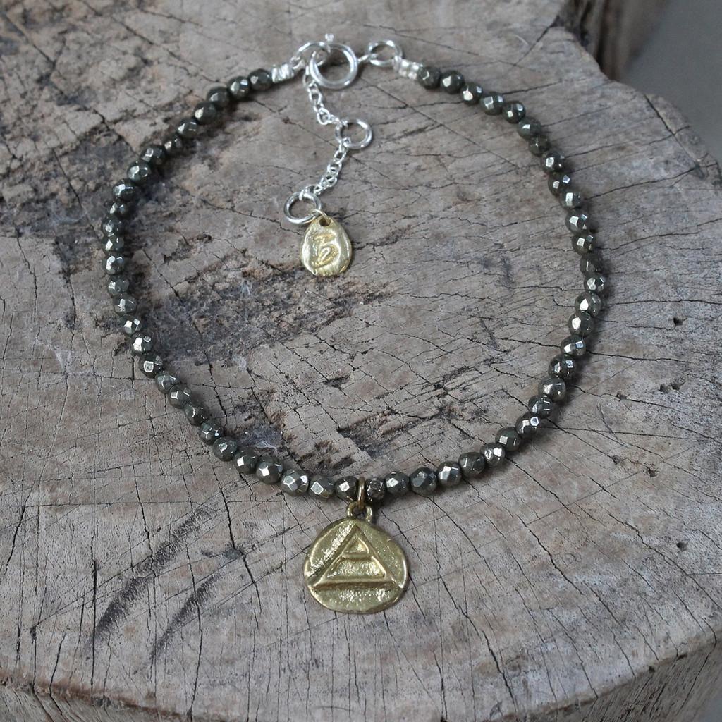 brass 'explore' glyph bracelet with genuine hematite stones
