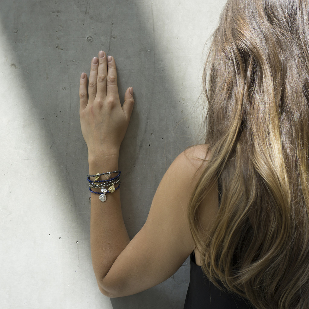 mindful bracelets with inspirational glyphs and genuine gem stones