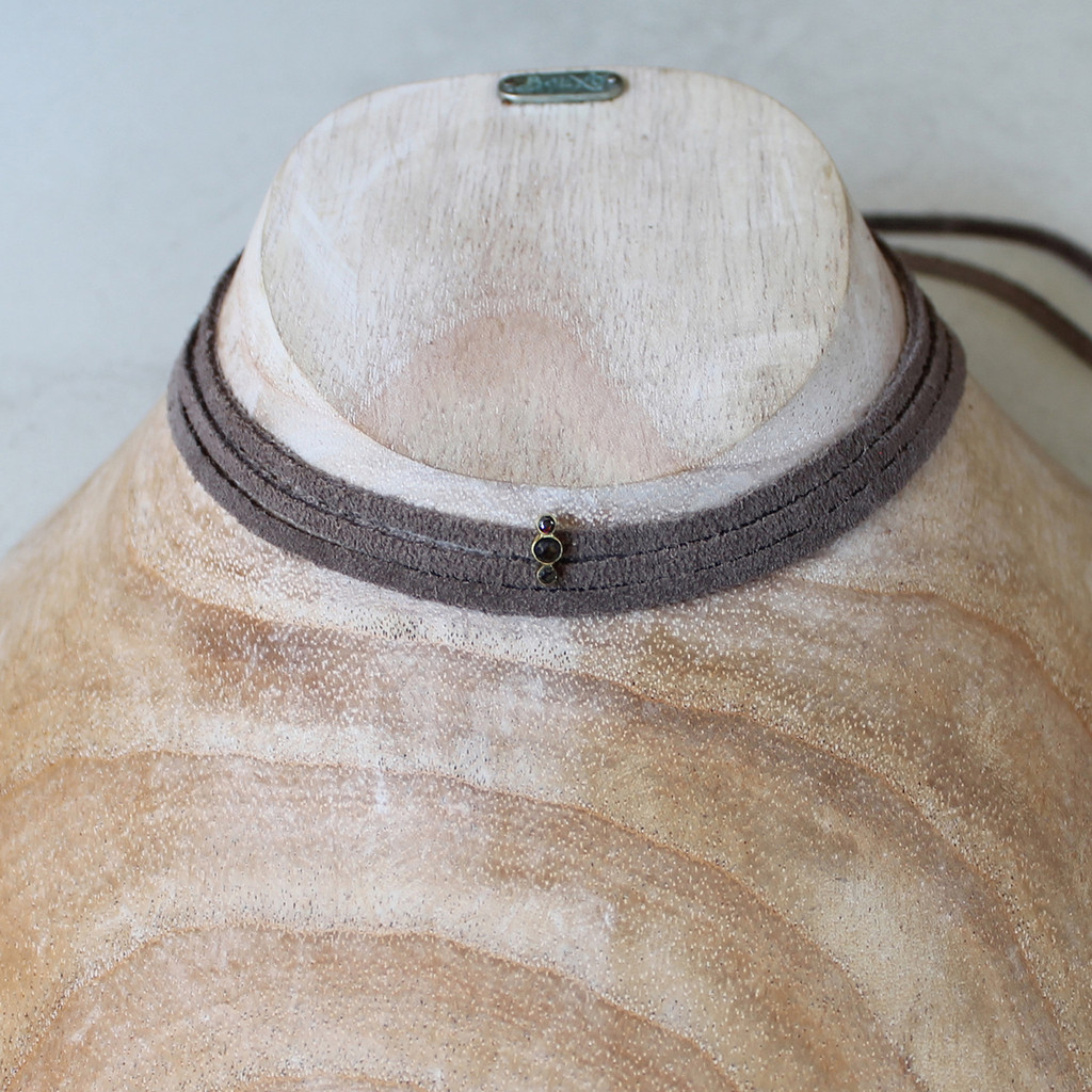 grey leather wrap necklace with brass and smoky quartz detail
