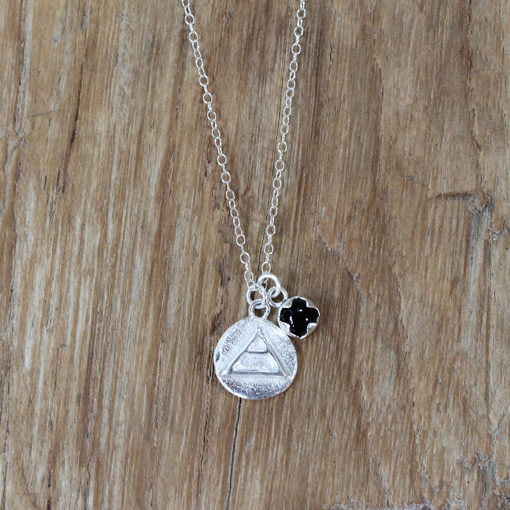 silver 'explore' charm necklace with black onyx stone detail