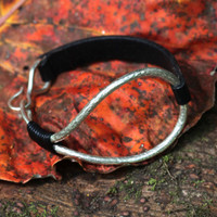 Thin black leather bracelet with silver details