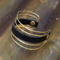 Unique brass cuff with chocolate brown leather detail