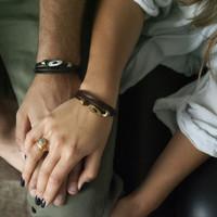 White bronze silver toggle closure on black leather multi wrap bracelet