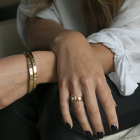 Polished brass wrap bangle with ALLOW YOURSELF TO DREAM detail