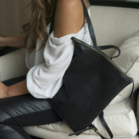 minimalist design black leather backpack with top zipper and adjustable straps