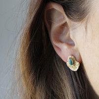 brass textured studs with a bold bezel and turquoise stone detail
