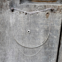 Sterling silver chain with a silver plated bar and black onyx stone detail