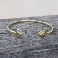 adjustable brass bracelet featuring Protect glyph symbol