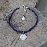 silver 'protect' glyph bracelet with genuine lapis lazuli stones
