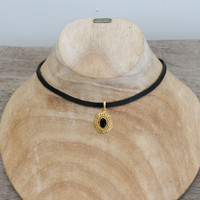 Black leather with gold plated pendant featuring black agate stone