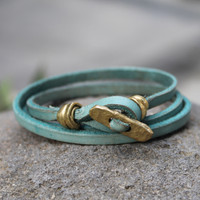 Brass toggle closure on sage leather multi wrap bracelet
