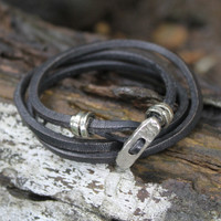 Silver toggle closure on black leather multi wrap bracelet