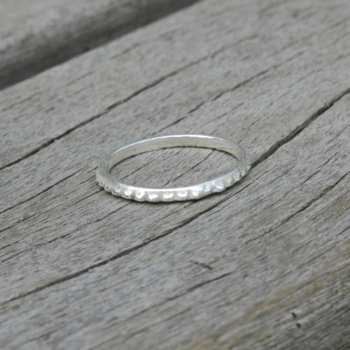 delicate simple sterling silver stacking ring with a bit of edge