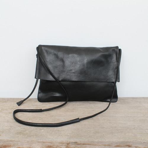 black genuine leather fold over crossbody bag with minimalist adjustable strap