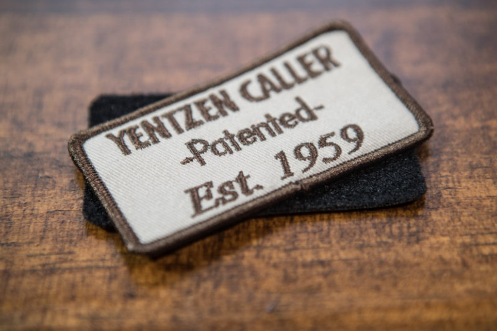 """YENTZEN CALLER PATCH (VELCRO or IRON ON)     From the inventors of the double reed, triple reed duck call, and the YENTZEN CALLER....   Our new popular YENTZEN CALLER Logo Patch that you can put on all your favorite hunting gear and show off your YENTZEN pride!!!  The first double reed patented in 1950 by George Yentzen and perfected by World Champion and Hall of Fame Member, James """"Cowboy"""" Fernandez, YENTZEN CALLER stands as a Waterfowl Icon and timeless perfection with its sound and durability that's lasted over 60 years!    Let 'em know your call is the only call and has the waterfowl heritage and history to back it up, with the YENTZEN patch!"""