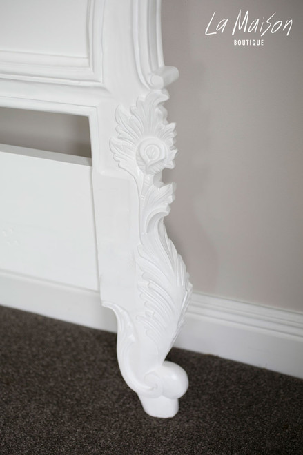 Hand carved details on each leg of the headboard