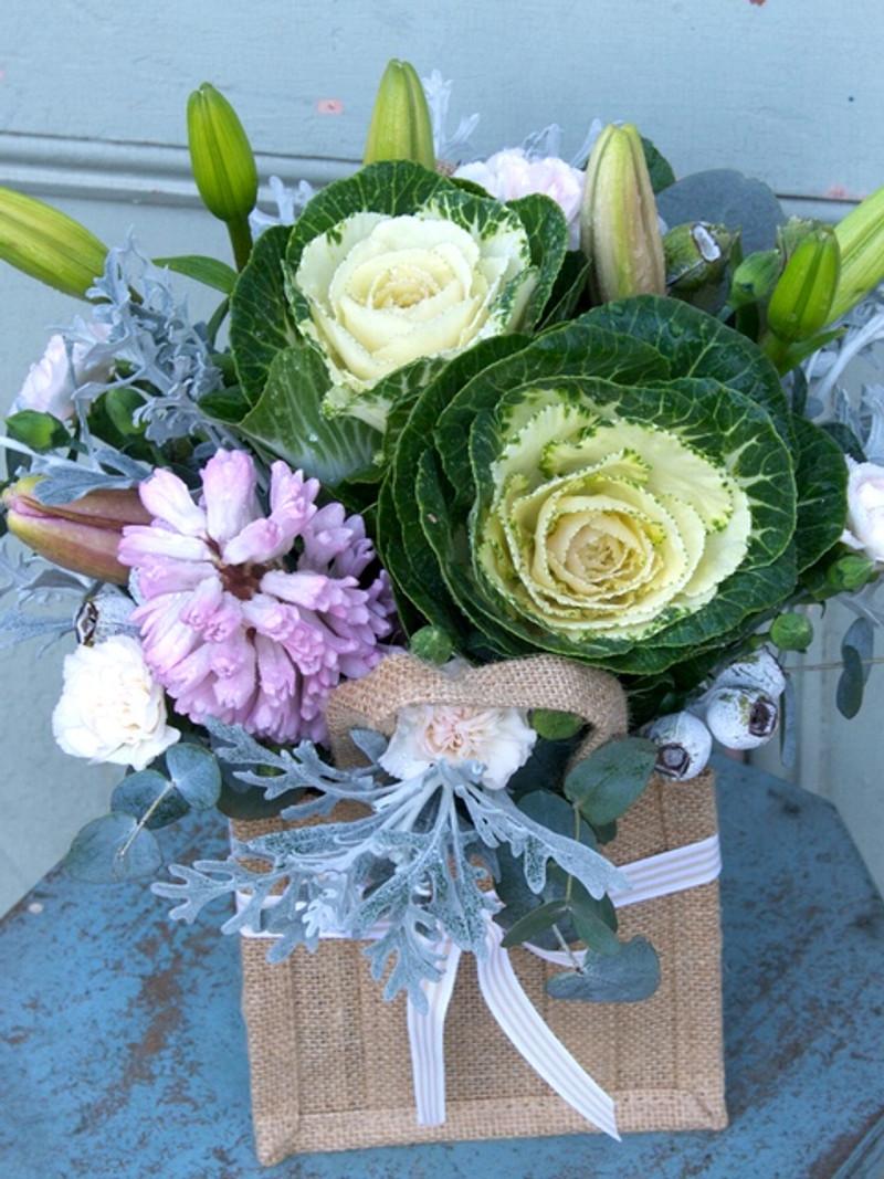 Flowers arranged into Jute Bag in a vintage colour palette