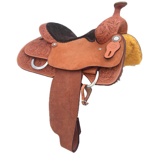 New Roping Saddle by Fort Worth Saddle Co with 15.5 inch seat. Natural rough out with tooled pommel, cantle and skirts,with black padded seat. Gullet size is 6.3 inch. Made in USA. Limited lifetime warranty.
