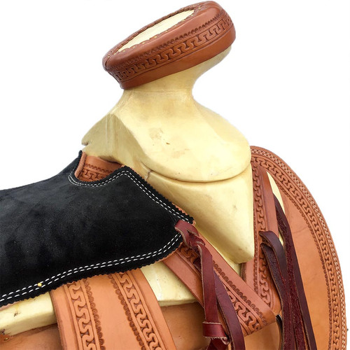 New Saddle by individual maker with 15 inch seat. Light oil Charro saddle with black padded seat. Gullet size is 5 inch.
