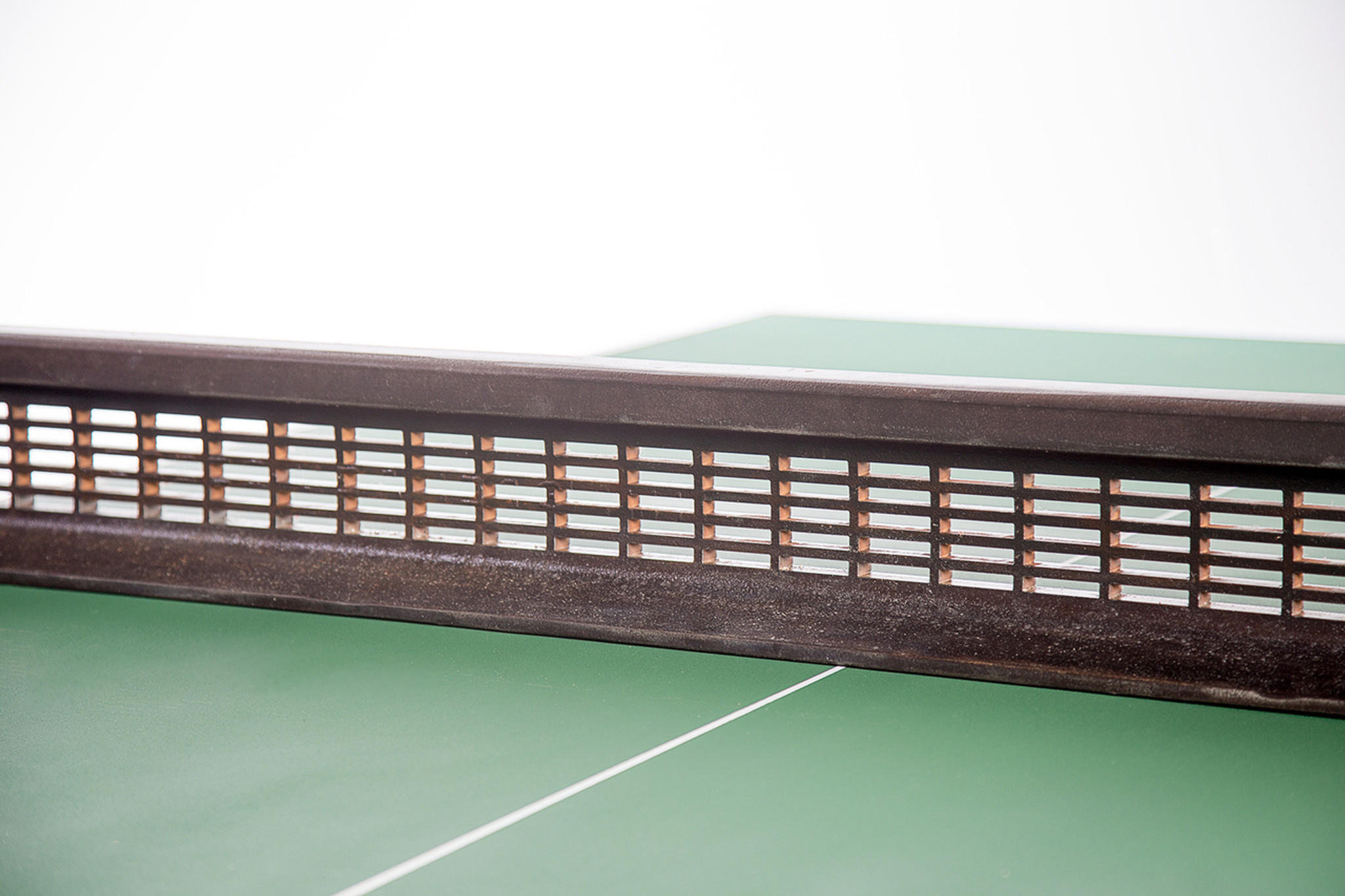 Metal ping pong net on durable high-end table tennis table custom crafted from reclaimed industrial materials