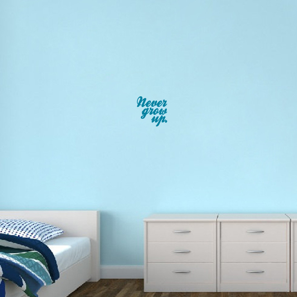 "Never Grow Up Wall Decal 12"" wide x 12"" tall Sample Image"