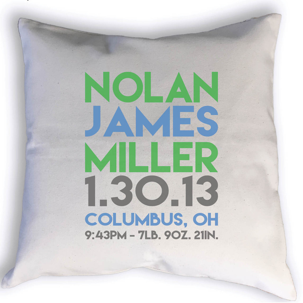 Custom Birth Stats throw pillow with name, birth date, city, state, time, weight & length. Image shows stats printed in blue, green and grey.