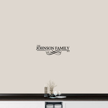"Custom Family Name With Scroll Wall Decal 24"" wide x 7"" tall Sample Image"