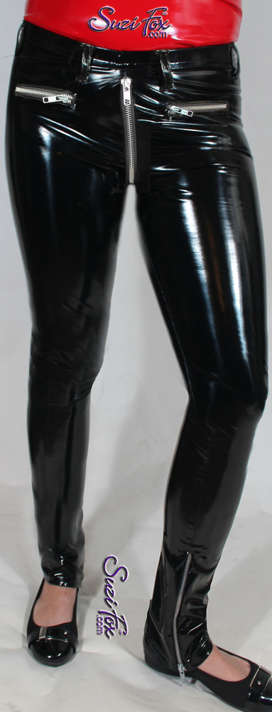Womens 5 Zipper Leggings with crotch zipper, faux zippered pockets, and ankle zippers shown in Gloss Black Vinyl/PVC, by Suzi Fox.  • Choice of zippers. • Choose any fabric on this site, including vinyl/PVC, metallic foil, metallic mystique, wetlook lycra Spandex, Milliskin Tricot Spandex. The vinyl/PVC is a latex alternative, great for people allergic to latex! • Optional custom sizing. • Plus size available. • 1 inch elastic at the waist. • Optional rear patch pockets. • Optional belt loops. • Worldwide shipping. • Made in the U.S.A.