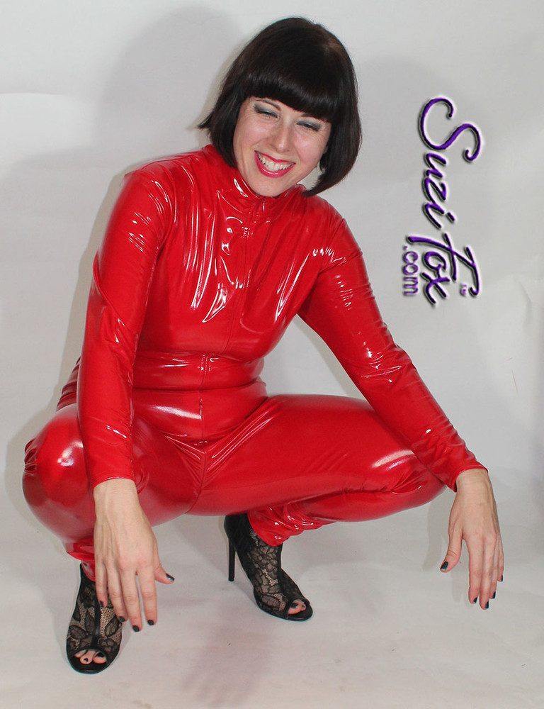 """Yes, it stretches! Custom Catsuit by Suzi Fox shown in Red Gloss Vinyl coated Nylon Spandex.  You can order this Catsuit in almost any fabric on this site.  • Available in black, red, white, light pink, neon pink, fuchsia, purple, royal blue, navy blue, turquoise, black matte (no shine), white matte (no shine) stretch vinyl coated spandex. • Optional 1 or 2-slider crotch zipper, and """"Selene"""" from Underworld TS Brass zipper. • Optional wrist zippers • Optional ankle zippers • Optional finger loops • Made in the U.S.A."""