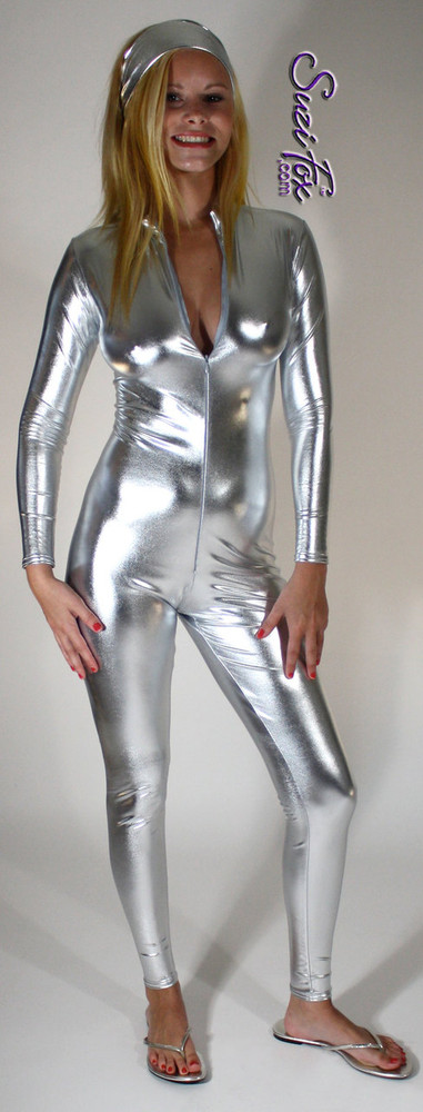 "Custom Catsuit by Suzi Fox shown in Silver metallic foil coated Nylon Spandex.  You can order this Catsuit in almost any fabric on this site.  • Available in gold, silver, copper, royal blue, purple, turquoise, red, green, fuchsia, gun metal, black faux leather/rubber Metallic foil coated spandex. • Your choice of front or back zipper (front zipper shown). • Optional 1 or 2-slider crotch zipper, and ""Selene"" from Underworld TS Brass zipper, or aluminum circular slider zipper like Catwoman comic characters. • Optional wrist zippers • Optional ankle zippers • Optional finger loops • Optional rear patch pockets • Made in the U.S.A."