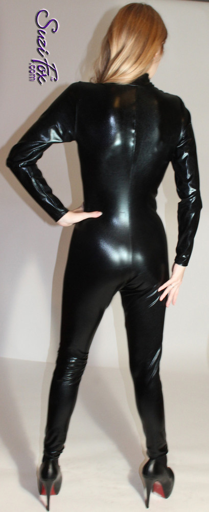 "Womens Custom Catsuit shown in Black Faux Leather/Rubber metallic foil coated spandex, custom made by Suzi Fox.  You can order this Catsuit in almost any fabric on this site.  • Available in gold, silver, copper, royal blue, purple, turquoise, red, green, fuchsia, gun metal, black faux leather/rubber Metallic foil coated spandex. • Your choice of front or back zipper (front zipper shown). • Optional 1 or 2-slider crotch zipper, and ""Selene"" from Underworld TS Brass zipper, or aluminum circular slider zipper like Catwoman comic characters. • Optional wrist zippers • Optional ankle zippers • Optional finger loops • Optional rear patch pockets • Made in the U.S.A. • Plus sizes available"