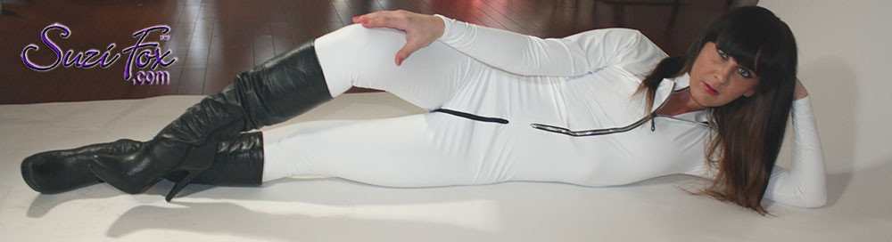"Custom Catsuit by Suzi Fox shown in Matte White (no shine) Vinyl/PVC coated Nylon Spandex. Shown with optional 1-slider crotch zipper. You can order this Catsuit in almost any fabric on this site.  • Available in black matte (no shine), white matte (no shine), and gloss black, red, white, light pink, neon pink, fuchsia, purple, royal blue, navy blue, turquoise, stretch vinyl coated spandex. • Your choice of front or back zipper (front zipper shown). • Optional 1 or 2-slider crotch zipper, and ""Selene"" from Underworld TS zipper, or aluminum circular slider zipper like Catwoman comic characters. • Optional wrist zippers • Optional ankle zippers • Optional finger loops • Optional rear patch pockets • Made in the U.S.A."
