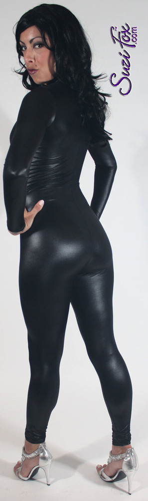 "Custom Catsuit by Suzi Fox shown in Black Wet Look Lycra Spandex.  You can order this Catsuit in almost any fabric on this site.  • Available in black, red, white, turquoise, navy blue, hot pink, lime green, green, yellow, royal blue, steel gray, neon orange. This is a 4-way stretch fabric with a medium shine. • Your choice of front or back zipper (front zipper shown). • Optional 1 or 2-slider crotch zipper, and ""Selene"" from Underworld TS Brass zipper, or aluminum circular slider zipper like Catwoman comic characters. • Optional wrist zippers • Optional ankle zippers • Optional finger loops • Optional rear patch pockets • Made in the U.S.A."