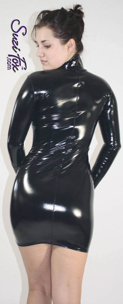 Turtleneck, Long Sleeved Mini Dress in Gloss Black Vinyl coated Nylon Spandex, custom made by Suzi Fox. Zipper in the back. Choose any fabric on this site! Available in black, white, red, navy blue, royal blue, turquoise, purple, fuchsia, neon pink, light pink, matte black (no shine), matte white (no shine) stretch vinyl/PVC coated nylon spandex. • Optional 2-slider zipper going the length of the dress, front or back, unzip from the top of the bottom! • Optional bust cutout. • Optional wrist zippers. Made in the U.S.A.