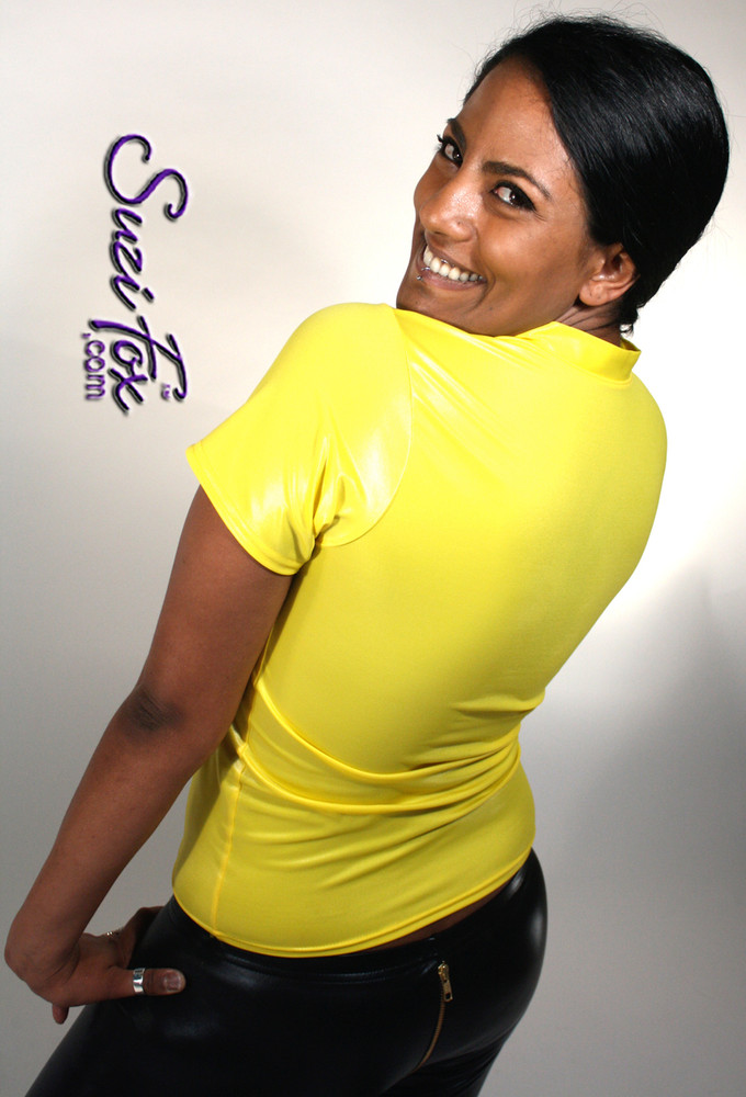 Womens V Neck T-Shirt in Yellow Wetlook Spandex, custom made by Suzi Fox. Custom made to your measurements! Choose any fabric on this site! Available in black, white, red, turquoise, navy blue, royal blue, hot pink, lime green, green, yellow, steel gray, neon orange. • Optional wrist zippers if you choose long sleeves. Made in the U.S.A.