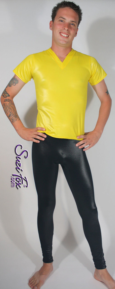 Mens Smooth Front, Hiphugger Leggings shown in Black Wetlook Lycra Spandex, custom made by Suzi Fox. Custom made to your measurements! • Available in black, white, red, turquoise, navy blue, royal blue, hot pink, lime green, green, yellow, steel gray, neon orange Wet Look and any fabric on this site. • 1 inch no-roll elastic at the waist. • Choose your ankle size - tight ankles, jean cut, boot cut, or bellbottom. • Optional ankle zippers. • Optional belt loops. • Optional rear patch pockets. Made in the U.S.A.