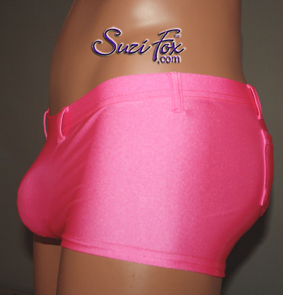 Mens Super low rise, Smooth Front shorts shown in Neon Pink Milliskin Tricot Spandex, custom made by Suzi Fox. Custom made to your measurements! • Available in black, white, red, royal blue, sky blue, turquoise, purple, green, neon green, hunter green, neon pink, neon orange, athletic gold, lemon yellow, steel gray Miilliskin Tricot spandex and any fabric on this site. • 1 inch no-roll elastic at the waist. • Optional belt loops. • Optional rear patch pockets. • Your choice of inseam and rise. 2 inch inseam is standard. • Made in the U.S.A.
