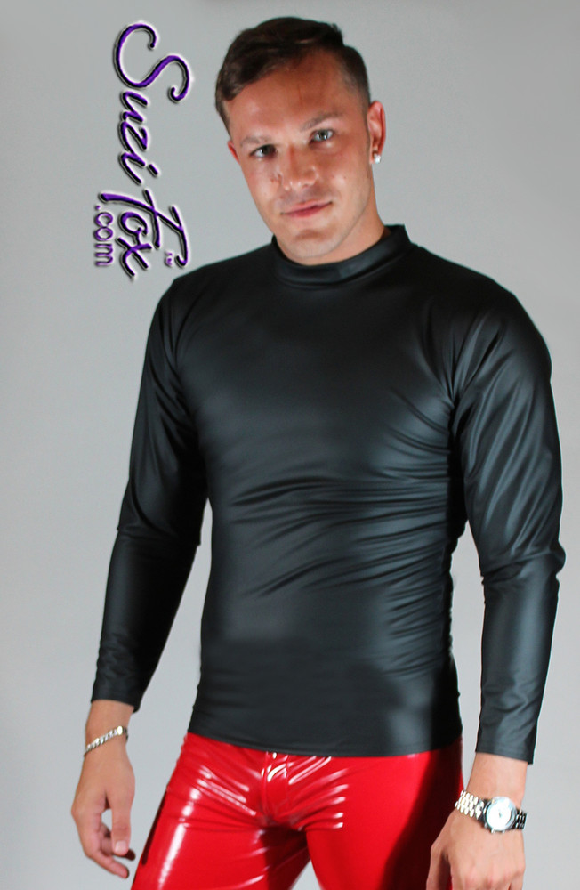 Mens Tee Shirt shown in Black Matte (no shine) Vinyl/PVC Spandex, custom made by Suzi Fox. • Long sleeve shown. • Available in matte black (no shine), matte white (no shine), gloss black, white, red, navy blue, royal blue, turquoise, purple, Neon Pink, fuchsia, light pink, black 3D Prism, red 3D Prism, Turquoise 3D Prism, Baby Blue 3D Prism, Hot Pink 3D Prism, and any fabric on this site. • Choose your sleeve length. • Give us your measurements for a custom fit! • Standard length is 24 inches (61 cm) for sizes XXXS-Medium; 27 inches (68.6 cm) for sizes Large and up. • Optional add extra length to the shirt. • Made in the U.S.A.