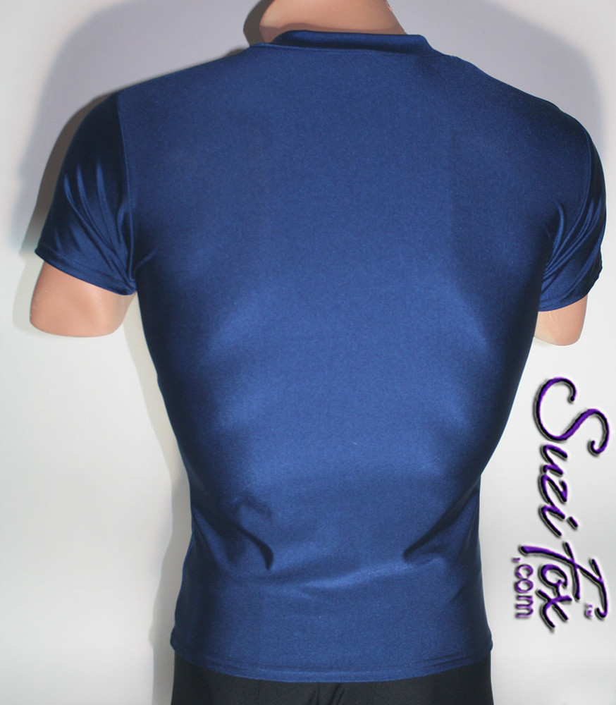 Mens V Neck Tee Shirt shown in Navy Blue Milliskin Tricot Spandex, custom made by Suzi Fox. • Available in black, white, red, royal blue, sky blue, turquoise, purple, green, neon green, hunter green, neon pink, neon orange, athletic gold, lemon yellow, steel gray Miilliskin Tricot spandex, and any fabric on this site. • Choose your sleeve length. • Give us your measurements for a custom fit! • Standard length is 24 inches (61 cm) for sizes XXXS-Medium; 27 inches (68.6 cm) for sizes Large and up. • Optional add extra length to the shirt. • Made in the U.S.A.