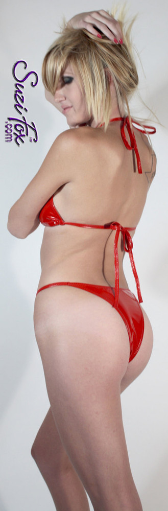 Adjustable Triangle String Bikini Top shown in Red Vinyl/PVC Spandex, custom made by Suzi Fox. • Adjustable! Make it thinner or wider! Available in black, white, red, navy blue, royal blue, turquoise, purple, Neon Pink, fuchsia, light pink, matte black (no shine), matte white (no shine), black 3D Prism, red 3D Prism, Turquoise 3D Prism, Baby Blue 3D Prism, Hot Pink 3D Prism Vinyl/PVC, and any fabric on this site. • Bottom sold separately. (B7 rio bikini shown) • Made in the U.S.A.