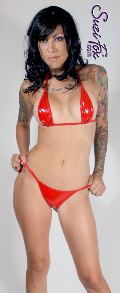 Teardrop String Bikini Top shown in Red Vinyl/PVC Spandex, custom made by Suzi Fox. • One Size. 3 inches (7.6 cm) wide at widest point, 7 inches (17.8 cm) tall. • Available in black, white, red, navy blue, royal blue, turquoise, purple, Neon Pink, fuchsia, light pink, matte black (no shine), matte white (no shine), black 3D Prism, red 3D Prism, Turquoise 3D Prism, Baby Blue 3D Prism, Hot Pink 3D Prism Vinyl/PVC, and any fabric on this site. • Bottom sold separately. (B7 Rio Bikini Bottom shown) • Made in the U.S.A.