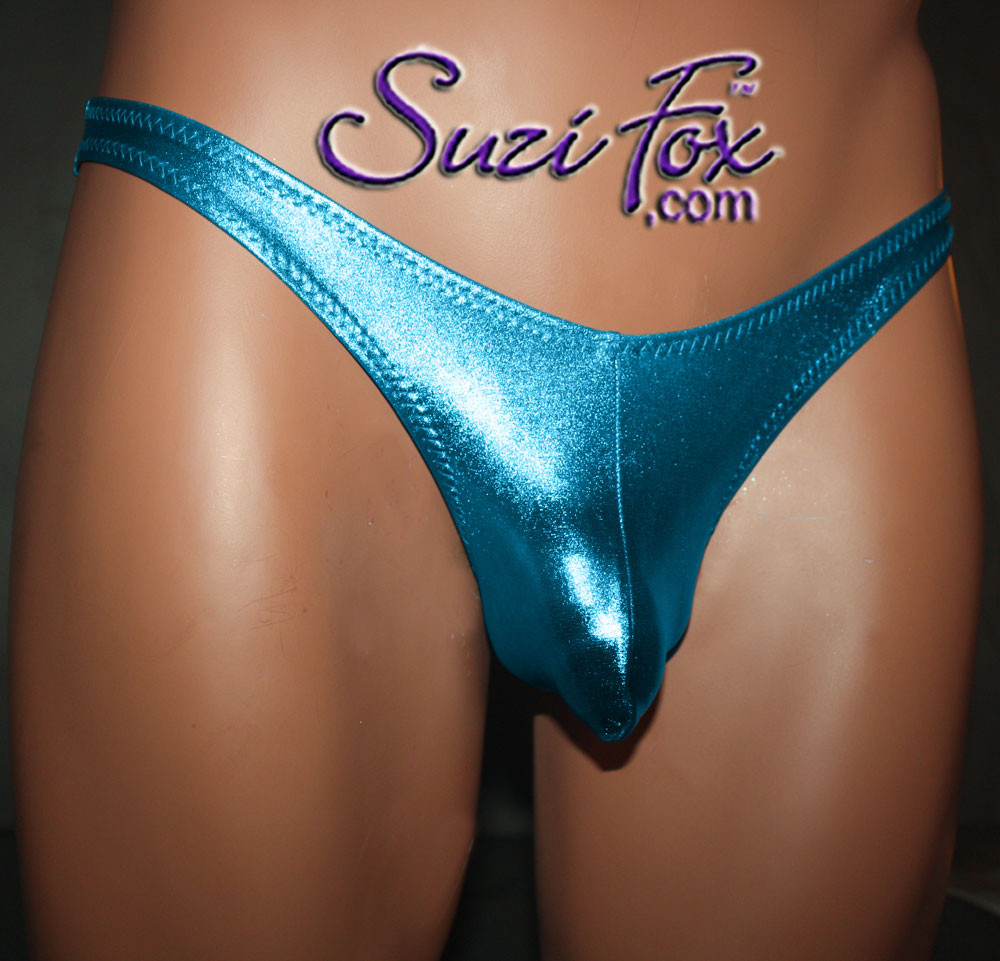 Mens Body Builder Posing suit - wide strap - shown in Turquoise Metallic Foil Spandex, custom made by Suzi Fox. • Available in gold, silver, copper, gunmetal, turquoise, Royal blue, red, green, purple, fuchsia, black faux leather/rubber Metallic Foil or any fabric on this site. • Standard front height is 7 inches (17.8 cm) tall. • Available in 4, 5, 6, 7, 8, 9, and 10 inch front heights. • Choose your rear style and height! • Choose your pouch size. • Optional gathered rear to highlight the glutes. • Made in the U.S.A.