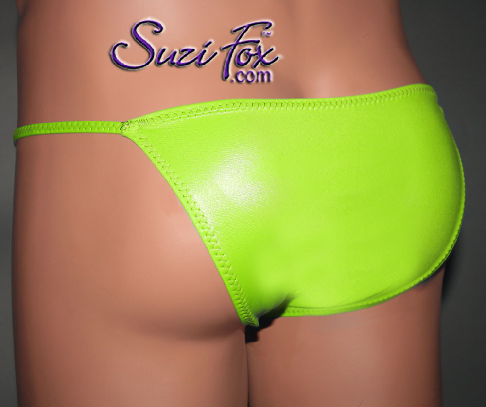 Mens Smooth Front, Skinny Strap, Brazilian Bikini - shown in Lime Green Wetlook Lycra Spandex, custom made by Suzi Fox. • Available in black, white, red, turquoise, navy blue, royal blue, hot pink, lime green, green, yellow, steel gray, neon orange Wet Look or any fabric on this site. • Standard front height is 7 inches (17.8 cm). • Available in 4, 5, 6, 7, 8, 9, and 10 inch front heights. • Wear it as swimwear OR underwear! • Made in the U.S.A.