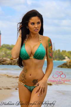 Sugar & Spice Emerald Green Hologram bikini top with Trickling Crystal Rhinestones. • Top is lined. • Optional Padding can be added to top. • Connectors: Crystal Rhinestones in Silver Settings • Perfect for competition posing bikini! Custom made in the U.S.A. Top and bottom sold separately.   Shown with optional Sugar & Spice Emerald Green Hologram bikini bottom with Trickling Crystal Rhinestones. • Your choice of Micro or Brazilian scrunch butt. • Bottom is lined in the front.   Rhinestones: COVERED in over 1,000 AB Rhinestones