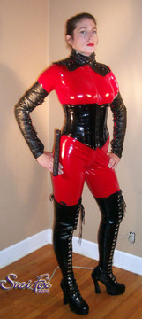 """Custom Catsuit by Suzi Fox shown in Red Gloss Vinyl coated Nylon Spandex.  You can order this Catsuit in almost any fabric on this site.  Great for a Mord Sith costume! • Available in black, red, white, light pink, neon pink, fuchsia, purple, royal blue, navy blue, turquoise, black matte (no shine), white matte (no shine) stretch vinyl coated spandex. • Your choice of front or back zipper (front zipper shown). • Optional 1 or 2-slider crotch zipper, and """"Selene"""" from Underworld TS Brass zipper, or aluminum circular slider zipper like Catwoman comic characters. • Optional wrist zippers • Optional ankle zippers • Optional finger loops • Made in the U.S.A."""
