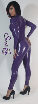 "Custom Catsuit by Suzi Fox shown in Purple Gloss Vinyl/PVC coated Nylon Spandex.  You can order this Catsuit in almost any fabric on this site.  • Available in black, red, white, light pink, neon pink, fuchsia, purple, royal blue, navy blue, turquoise, black matte (no shine), white matte (no shine) stretch vinyl coated spandex. • Your choice of front or back zipper (front zipper shown). • Optional 1 or 2-slider crotch zipper, and ""Selene"" from Underworld TS Brass zipper, or aluminum circular slider zipper like Catwoman comic characters. • Optional wrist zippers • Optional ankle zippers • Optional finger loops • Made in the U.S.A."