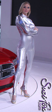 "Custom Catsuit by Suzi Fox shown in Silver metallic foil coated Nylon Spandex.  You can order this Catsuit in almost any fabric on this site.  • Available in gold, silver, copper, royal blue, purple, turquoise, red, green, fuchsia, gun metal, black faux leather/rubber Metallic foil coated spandex. • Your choice of front or back zipper (front zipper shown). • Optional 1 or 2-slider crotch zipper, and ""Selene"" from Underworld TS Brass zipper, or aluminum circular slider zipper like Catwoman comic characters. • Optional wrist zippers • Optional ankle zippers • Optional finger loops • Optional rear patch pockets • Made in the U.S.A. Many thanks to Kelly Kolhagen at MS&L Public Relations for sending us the picture of their model, Jordan, who is 6'4"" tall, wearing a custom Suzi Fox metallic silver catsuit!"