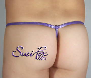 Men's Adjustable Pouch G-String thong - shown in Gloss Purple Vinyl/PVC Spandex, custom made by Suzi Fox. • Available in black, white, red, navy blue, royal blue, turquoise, purple, Neon Pink, fuchsia, light pink, matte black (no shine), matte white (no shine), black 3D Prism, red 3D Prism, Turquoise 3D Prism, Baby Blue 3D Prism, Hot Pink 3D Prism Vinyl/PVC or any fabric on this site. • Standard front height is 5 inches (12.7 cm) tall. • Available in 4, 5, 6, 7, 8, 9, and 10 inch front heights. • Choose your pouch size! • Wear it as swimwear OR underwear! Made in the U.S.A.